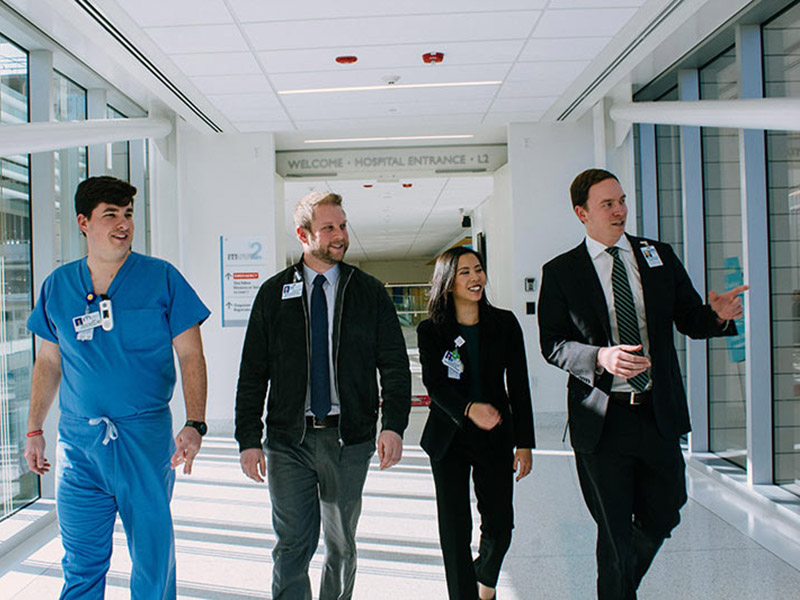 Graduates of the MHA program walking through a corridor in Children's Hospital in New Orleans. Photo by Katherine Socha.